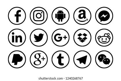 Valencia, Spain - January 11, 2018: Collection of popular social media logos printed on paper: Facebook, Android, Twitter, Tumblr, Reddit,Telegram, WeChat, Messenger, Instagram, Amazon, LinkedIn.