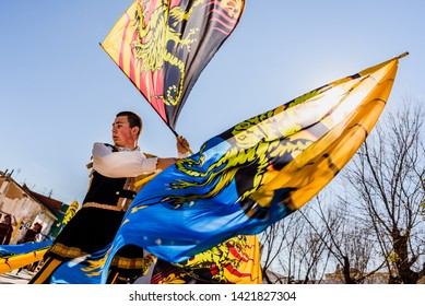 Valencia, Spain- January 27, 2019: Italian Flags-wavers, Sbandieratori, performing the traditional and antique dance by throwing flags in the air, during a medieval festival.