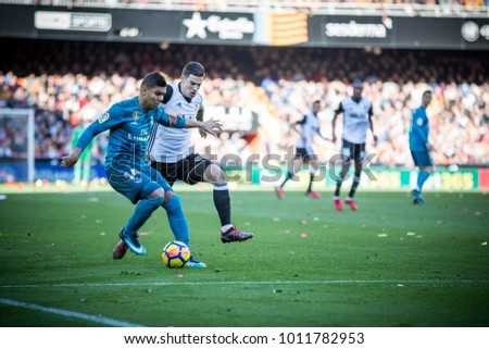 VALENCIA, SPAIN - JANUARY 27: (L) Casemiro, Mina during Spanish La Liga match between Valencia CF and Real Madrid at Mestalla Stadium on January 27, 2018 in Valencia, Spain