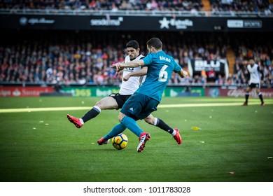 VALENCIA, SPAIN - JANUARY 27: Nacho, Guedes during Spanish La Liga match between Valencia CF and Real Madrid at Mestalla Stadium on January 27, 2018 in Valencia, Spain