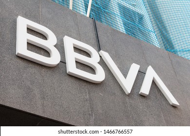VALENCIA, SPAIN - JULY 18, 2019. BBVA logo on BBVA bank branch office. BBVA is the second largest bank in Spain
