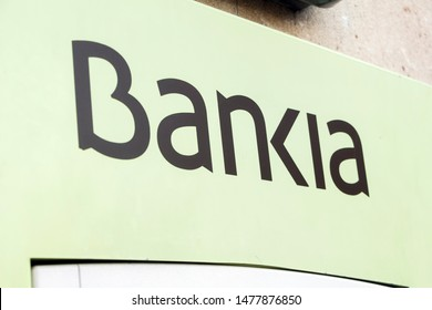 VALENCIA, SPAIN - JULY 18, 2019. Bankia logo on Bankia bank branch office. Bankia is a Spanish bank that was formed consolidating the operations of seven regional savings banks