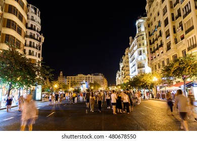 VALENCIA, SPAIN - JULY 23, 2016: People Walking At Night In Downtown Valencia City Of Spain.