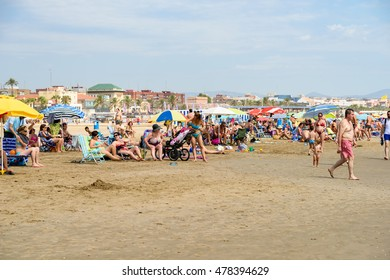 VALENCIA, SPAIN - JULY 24,  2016: People Have Fun At Balearic Sea On Valencia Beach In Summer.