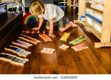 Valencia, Spain - July 3 2018: Children playing and learning with montessori color tablets