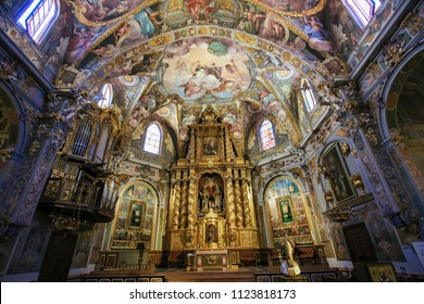 Valencia, Spain - June 15, 2018: 17th Century Frescoes and Altar in the Church of Saint Nicholas and Saint Peter Martyr in Valencia, Spain
