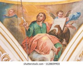 Valencia, Spain - June 15, 2018: 17th Century Fresco in the Church of Saint Nicholas and Saint Peter Martyr in Valencia, Spain, depicting St John the Evangelist