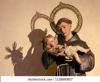 Valencia, Spain - June 15, 2018: Statue in the Church of Saint Nicholas and Saint Peter Martyr in Valencia, Spain, of Saint Anthony of Padua holding Baby Jesus