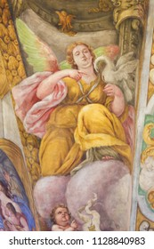 Valencia, Spain - June 15, 2018: 17th Century Fresco in the Church of Saint Nicholas and Saint Peter Martyr in Valencia, Spain, depicting an Angel and a Pelican wounding itself