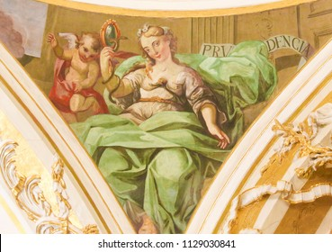 Valencia, Spain - June 15, 2018: 17th Century Fresco in the Church of Saint Nicholas and Saint Peter Martyr in Valencia, Spain, depicting the Cardinal Virtue Prudence
