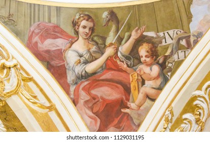 Valencia, Spain - June 15, 2018: 17th Century Fresco in the Church of Saint Nicholas and Saint Peter Martyr in Valencia, Spain, depicting athe Cardinal Virtue Justice