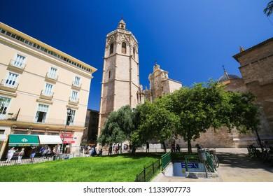Valencia, Spain - June 15, 2018: Valencia Cathedral (13th Century) and the Torre Del Micalet at the Plaza de la Almoina in the center of Valencia, Spain