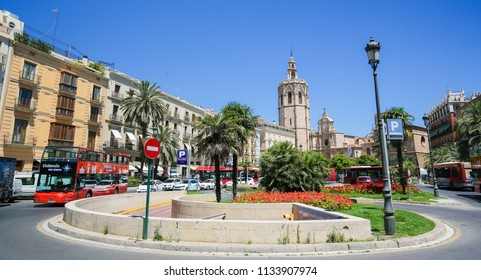 Valencia, Spain - June 15, 2018: Valencia Cathedral (13th Century) and the Torre Del Micalet at the Plaza de la Reina in the center of Valencia, Spain