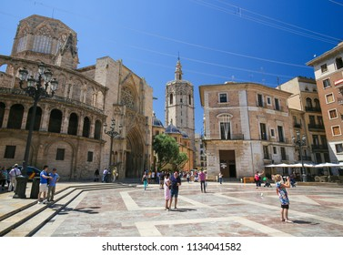 Valencia, Spain - June 15, 2018: Valencia Cathedral (13th Century) and the Torre Del Micalet at the Plaza de la Almoina in the center of Valencia, Spain