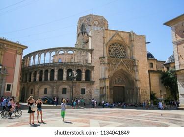 Valencia, Spain - June 15, 2018: Valencia Cathedral (13th Century) at the Plaza de la Almoina in the center of Valencia, Spain