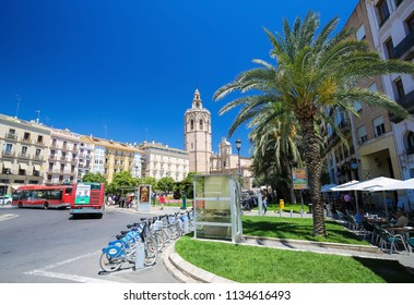 Valencia, Spain - June 15, 2018: Valencia Cathedral (13th Century) and the Torre Del Micalet seen from the Plaza de la Reina in the center of Valencia, Spain