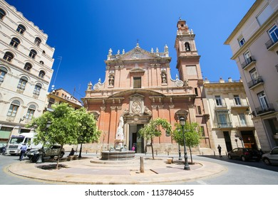 Valencia, Spain - June 15, 2018: Church and Tower of the Baroque Santo Tomas Church in the center of Valencia, Spain, dedicated to St Thomas and Philip Neri