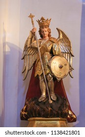Valencia, Spain - June 15, 2018: Statue of the Archangel Michael slaying Satan, in the Church of Saint Nicholas and Saint Peter Martyr in Valencia, Spain