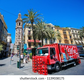 Valencia, Spain - June 15, 2018: View on a Coca Cola Truck and the Santa Catalina gothic tower in the center of Valencia, Spain