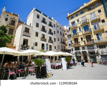Valencia, Spain - June 15, 2018: Terraces at restaurants at the Plaza Lope de Vega in the center of Valencia, Spain