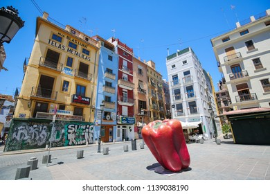 Valencia, Spain - June 15, 2018: Colorful houses and Bell Pepper at the Plaza del Doctor Collado in the center of Valencia, Spain