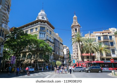 Valencia, Spain - June 15, 2018: View on buildings and the Santa Catalina gothic tower in the center of Valencia, Spain