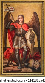Valencia, Spain - June 15, 2018: Medieval Painting in Valencia, Spain, depicting Saint Michael the Archangel slaying Satan