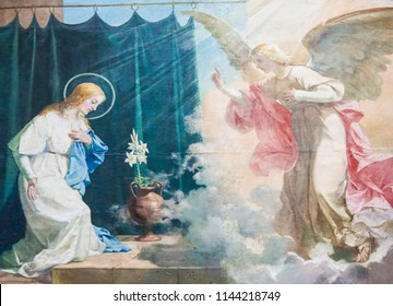 Valencia, Spain - June 15, 2018: Fresco of the Virgin Mary and the Archangel Gabriel at the Annunciation, in the Basilica of Valencia, Spain
