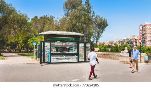 VALENCIA, SPAIN - June 16, 2017 : small newsstand in the street where passersby walk without looking at it