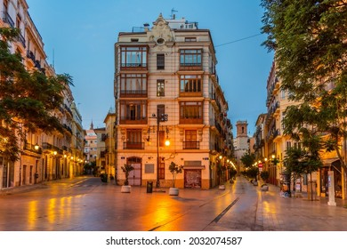 VALENCIA, SPAIN, JUNE 18, 2019: Sunrise view of Carrer dels Serrans street leading to Torre de Sant Bartomeu tower in Valencia, Spain