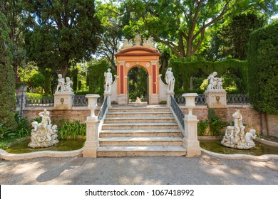 VALENCIA, SPAIN -june 19, 2015: Fragments of Monforte Gardens with an arch and statue compositions in Valencia, Spain. Park scenery concept