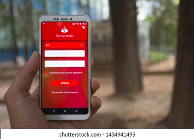 Valencia, Spain; June 26 2019:  Santander bank wallpaper and logo in a mobile app, Banco Santander is a Spanish bank and one of the most important banks in the world.