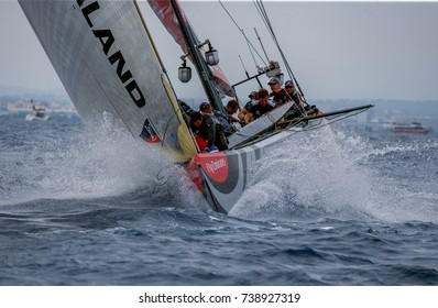 VALENCIA, SPAIN - JUNE 26: Unidentified crew members on board  Emirates Team New Zealand prepare for tack in final match race of 32nd America's Cup on June 26, 2007 in Valencia, Spain
