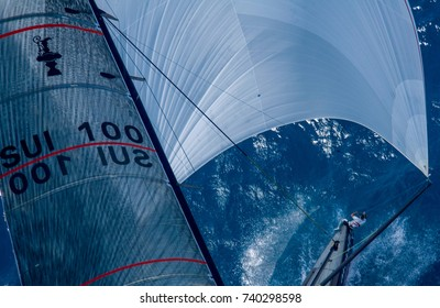 VALENCIA, SPAIN - JUNE 26: Unidentified crew member on board Switzerland's Alinghi prepares for jibe in final match race of 32nd America's Cup on June 26, 2007 in Valencia, Spain