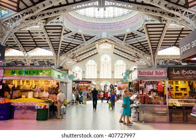 VALENCIA, SPAIN - June 29, 2015: Shopping in the market. Mercado Central of Valencia is one of the oldest in Europe. It combines lots of architectural styles from late gothic to modernism.