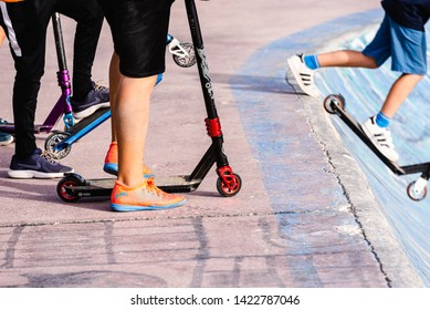 Valencia, Spain - June 8, 2019: Children, unrecognizable, with their sneakers, mounted on their skates in a skatepark.