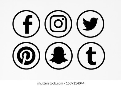 Valencia, Spain - March 05, 2019:  Collection of popular social media logos printed on paper: Facebook, Instagram, Twitter, Pinterest, Snapchat, Tumblr.