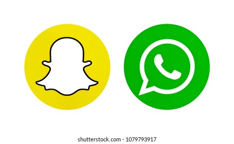 Valencia, Spain - March 08, 2017: Collection of popular social media logos printed on paper: Snapchat and WhatsApp.