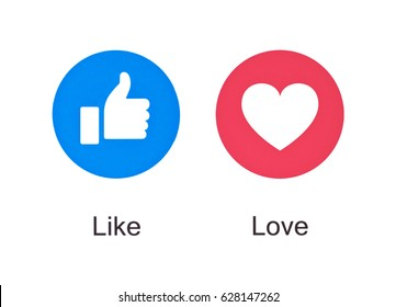 Valencia, Spain - March 08, 2017: Facebook like and love icons of Empathetic Emoji Reactions, printed on paper. Facebook is a  social networking service.