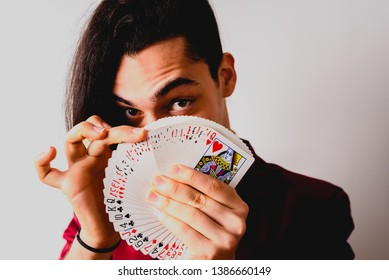 Valencia, Spain - March 1, 2019: magician doing tricks with a deck of cards.
