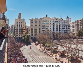 Valencia, Spain, March 10, 2019. Aerial view of the Plaza del Ayuntamiento, during the mascleta, in the fallas festival. Many people crowd the place to see the colorful smoke masclets explode.