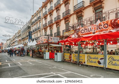 Valencia, Spain, March 14, 2018. Streets of Valencia during the festivities of Las Fallas. Typical food stalls, donuts and churros.