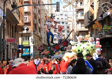 "VALENCIA, SPAIN - MARCH 14: People enjoying fallas (""the fires"" in Valencian), one of the biggest parties in Spain with near 400 wooden monuments on march 14, 2010 in Valencia, Spain"