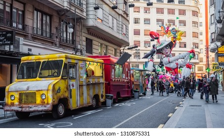 Valencia, Spain, March 15, 2018. Las Fallas of Valencia. Main streets with monuments falleros, retro trucks of food and drink and people walking and visiting the place.