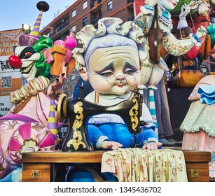 Valencia, Spain, March 17, 2019. Festival of the fallas of Valencia. L'antiga de Campanar, winner of the first special prize as the best falla of 2019.Grandma's ninot with sewing machine.