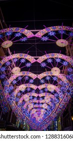 Valencia / Spain - March 18, 2017: A photo of the gorgeous illumination in the Sueca street in Valencia during Fallas 2017, a popular street that tourist visit during the famous fallas celebration