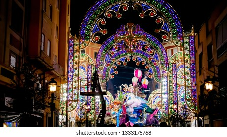 Valencia / Spain - March 18, 2017: Illuminated Falla sculpture at Cuba street in Russafa neighborhood during Las Fallas festival in Valencia, Spain. Beautiful street decorations with lights by night.