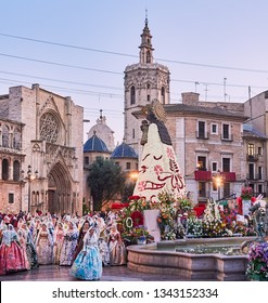 Valencia, Spain, March 18, 2019. Offering of the falleras and falleros, to the Virgin of desamparados in the square of the virgin, during the party of the Fallas of Valencia