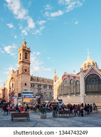 Valencia, Spain, March 18, 2019. Festival of las fallas. People enjoying the city in fallas, in the central market area and the church of Santos Juanes. Street food stalls in the place.