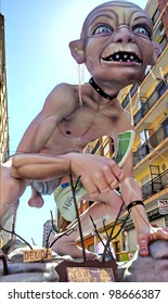 """VALENCIA, SPAIN - MARCH 18: """"A passar per l'aro"""" Falla with Gollum (""""the fires"""" in Valencian), one of the biggest parties in Spain with near 700 wooden monuments on march 18, 2012 in Valencia, Spain"""